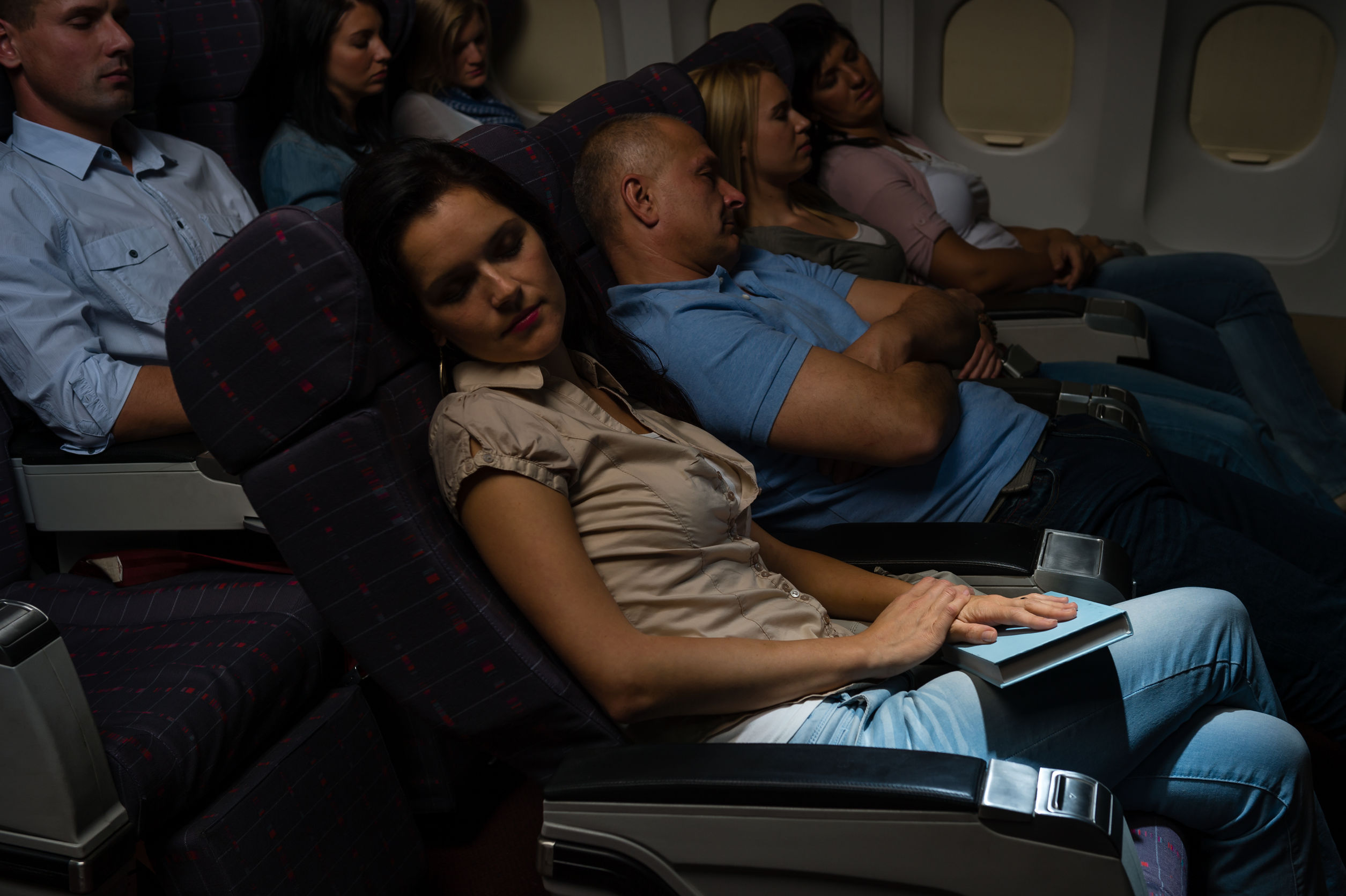 23714529 - flight passengers sleeping plane cabin night travel